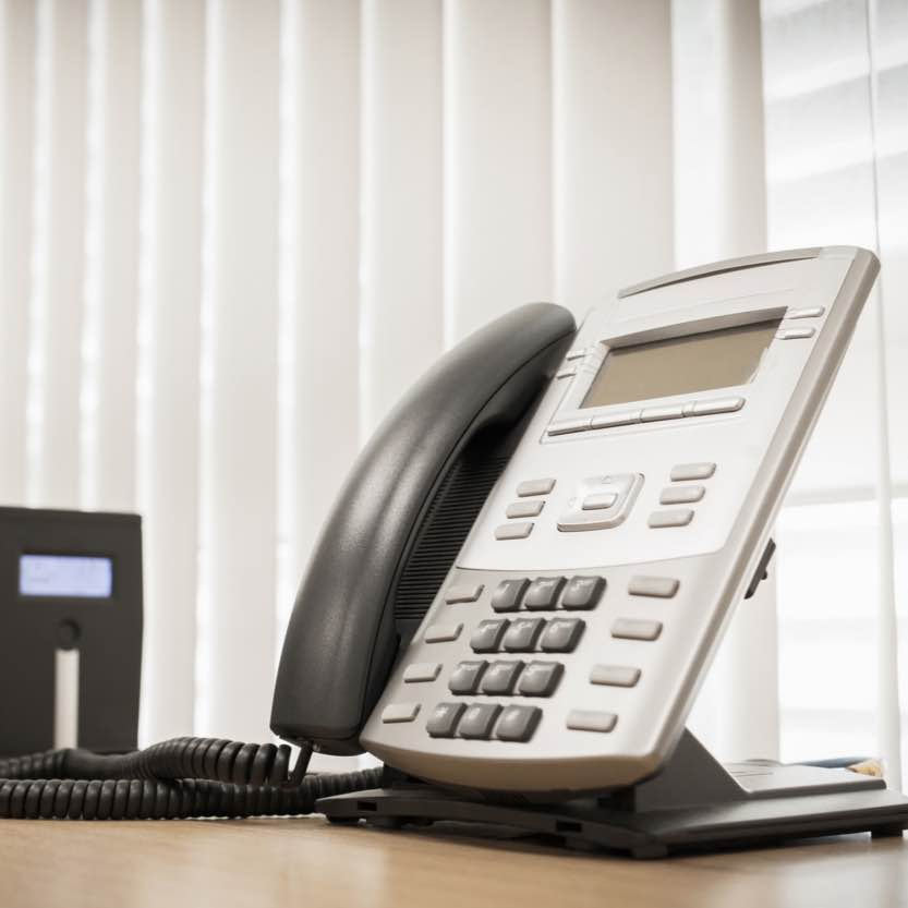 A VOIP phone on a desk